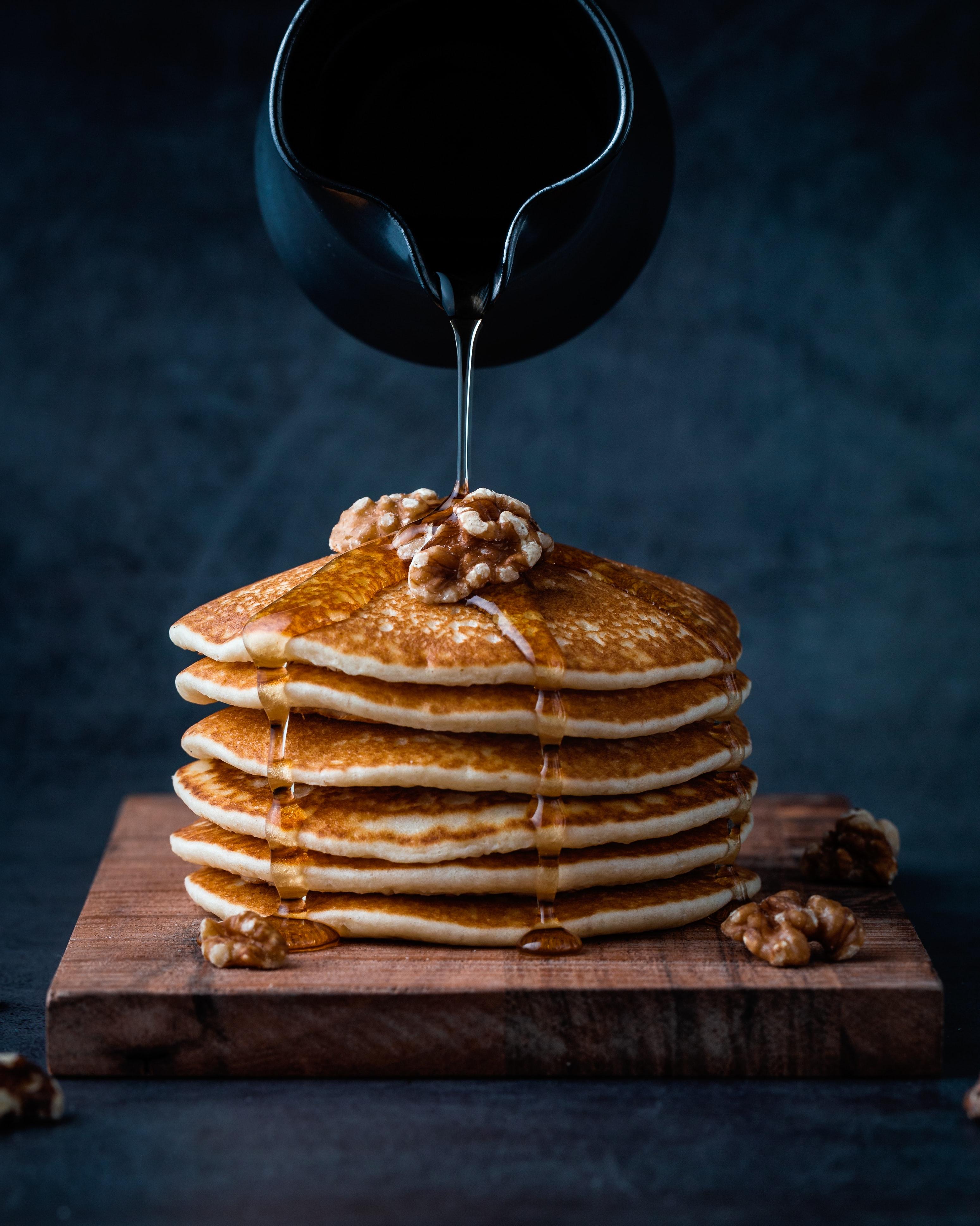 Drizzling Manuka Honey over layered Pancakes